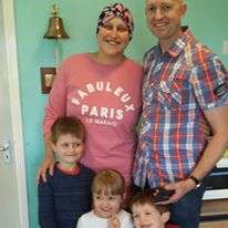 Helen Jones, our Warrior Wednesday spotlight, stands with her husband and three young kids (two boys and a girl) after she rang the bell at her treatment facility.