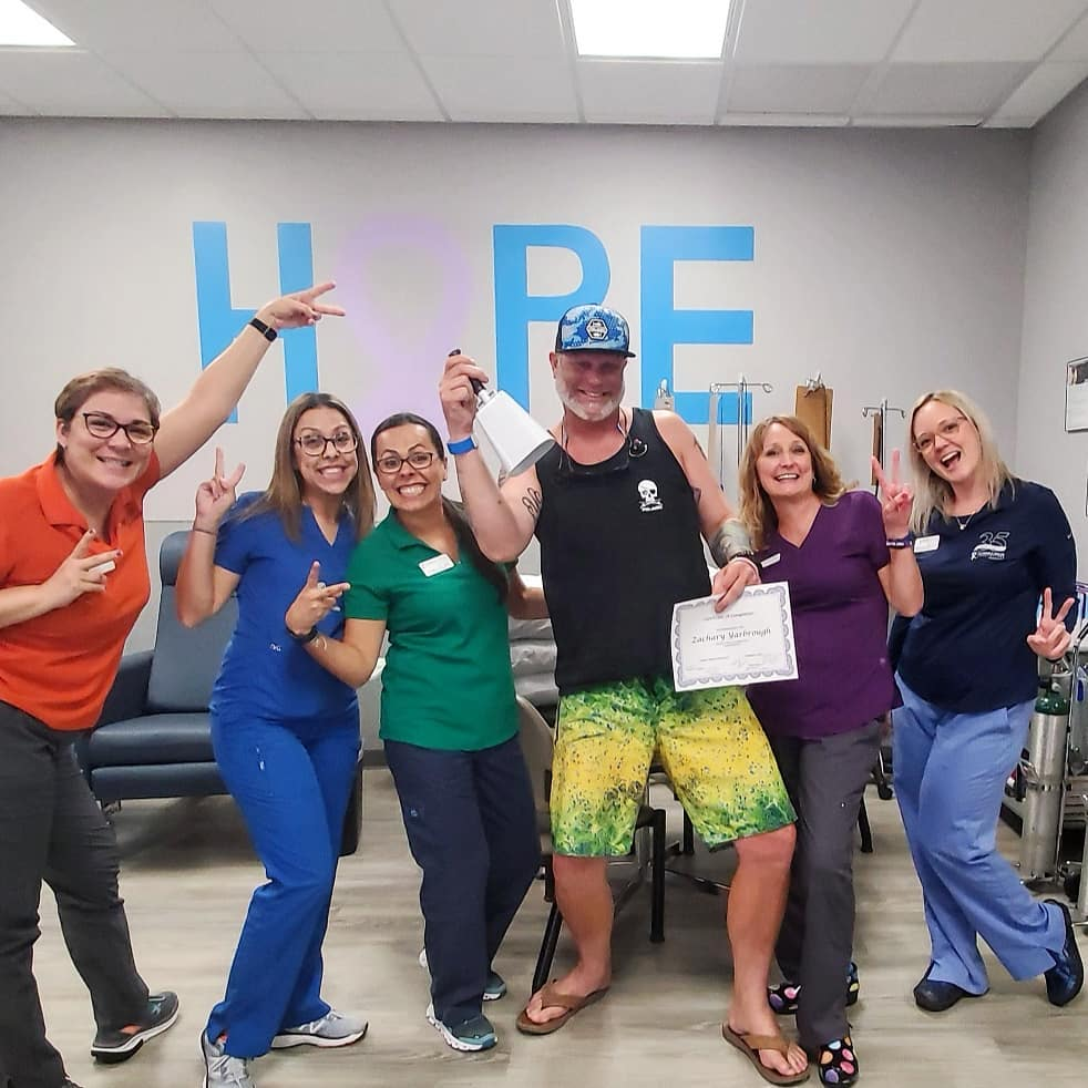 Our Warrior Wednesday spotlight, Zac Yarbrough, poses with hospital staff as he rings a white bell after one of his chemo treatments.